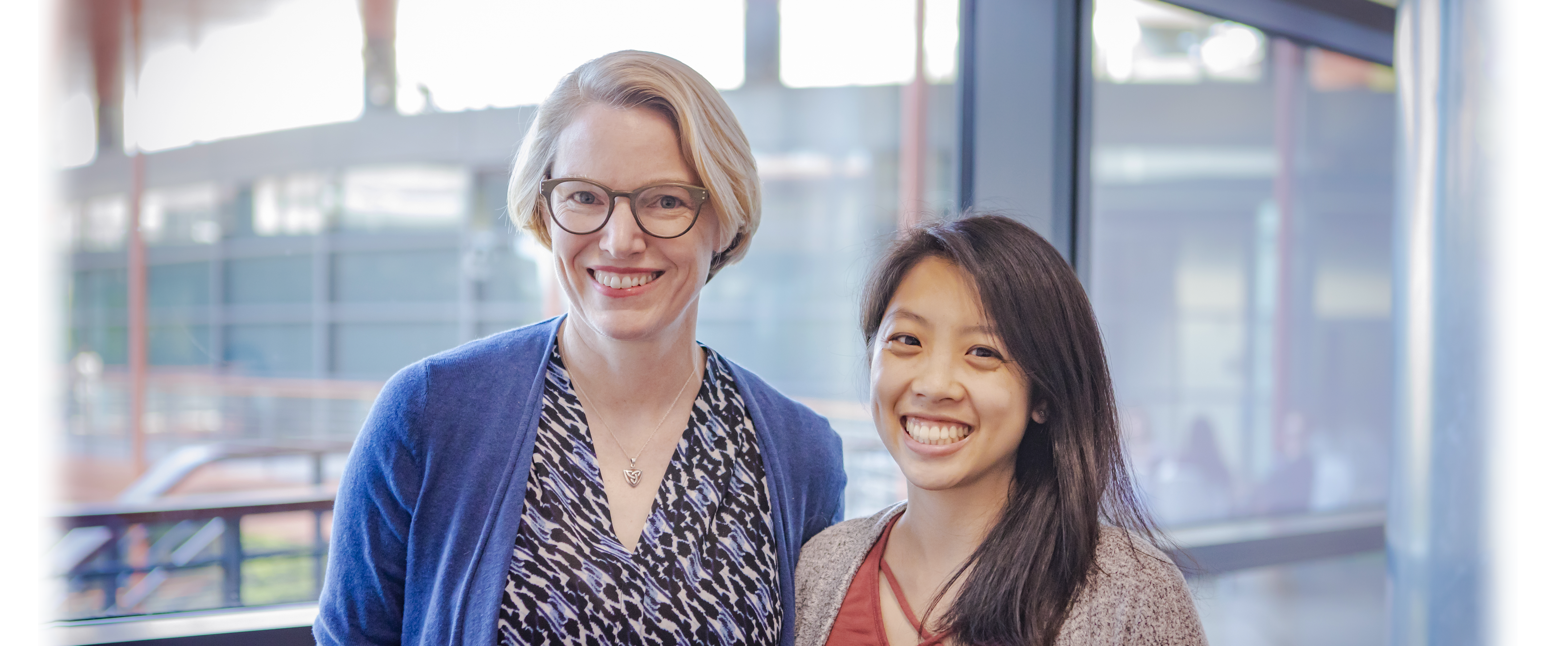 Photo of Dr. Alison Marsden and graduate student Melody Dong standing together at the Clark Center and smiling.
