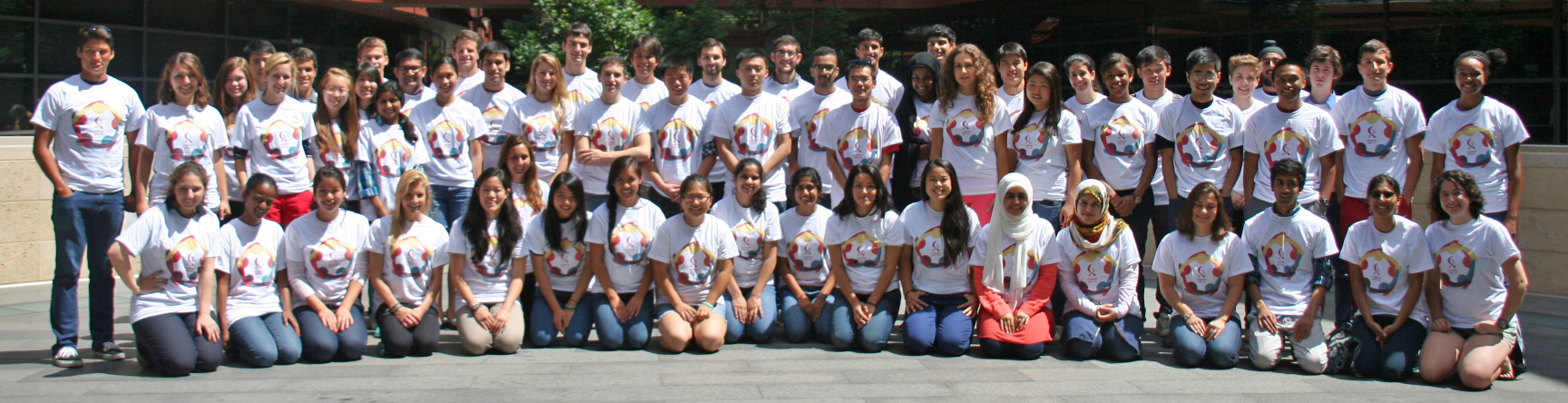 Photo of 75 undergraduates standing together at Clark in matching shirts.