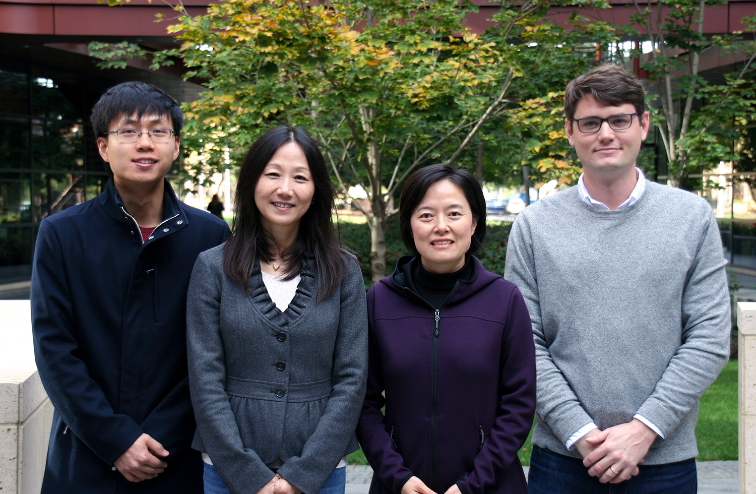 Still photo of Asian male graduate student, two Asian female faculty members, and a white male graduate student standing together at the Clark Center.