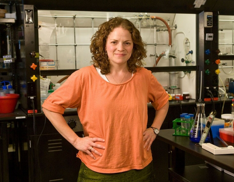 Photo of a female faculty member in a laboratory.
