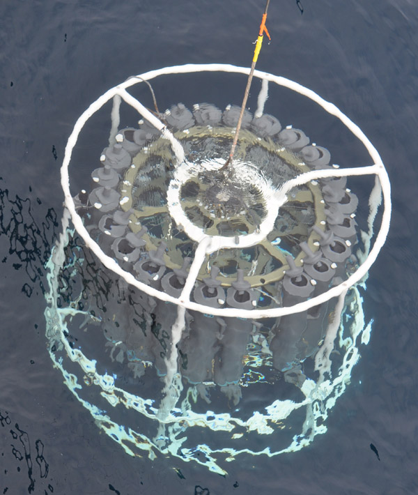 Photo of the large sampler device plunging into the water.
