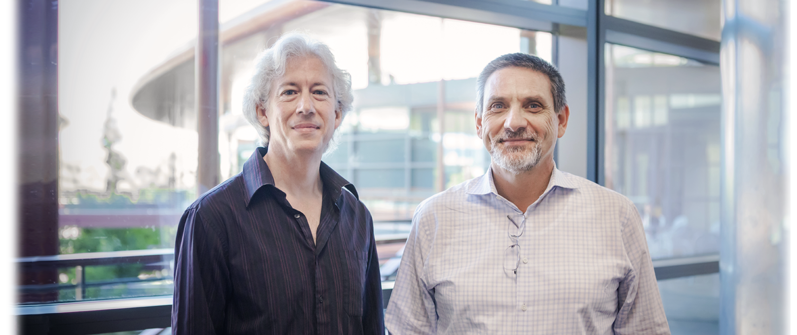 Photo of Drs. Daniel Palanker and Stephen Baccus standing together at the Clark Center.