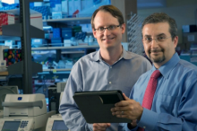 Photo of Ash Alizadeh and Maximilian Diehn in the lab.