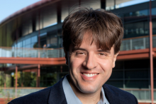 Photo of Dr. Karl Deisseroth standing outside of the Clark Center, home of Stanford Bio-X, at Stanford.