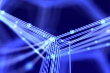 Graphic illustration of intersecting nanotubes lit up in blue against a darker background.