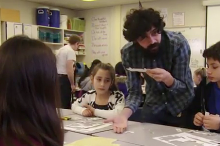 Screenshot from video of Dr. Manu Prakash showing students how to use the Foldscope.