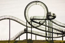 Photo of walkable roller coaster in Germany, with pathways which wrap around themselves and one large full upside-down loop at the top.