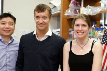 Photo of Dong Wang, Gregory Scherrer, and Elizabeth Sypek in the laboratory.
