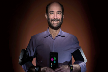 Photo of Dr. Michael Snyder using several wearable devices at once.