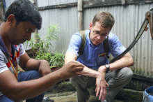 Photo of Dr. Stephen Luby with a teammate in Dhaka, Bangladesh, testing water samples.