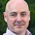 Photo of Dr. Christopher Re, Associate Professor of Computer Science at Stanford University.
