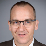 Photograph if a white-passing male faculty member wearing glasses, Dr. Detlef Obal, Assistant Professor of Anesthesiology, Perioperative & Pain Medicine at Stanford University.